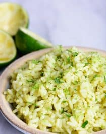 Cilantro Lime Rice Recipe - This Cilantro Lime Rice recipe makes a delicious, flavorful side dish recipe! Pairs perfectly with fish tacos, enchiladas, burritos, or so many other Mexican dishes! // addapinch.com