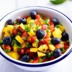 Mango Blueberry Salsa - This Mango Blueberry Salsa makes a fresh fruit salsa recipe perfect for serving with fish, chicken, or on a chip! // addapinch.com