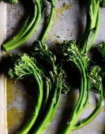 Roasted Broccoli Rabe Recipe - This Roasted Broccoli Rabe recipe makes a quick and easy side dish recipe perfect for weeknight meals! One simple step makes your broccoli rabe tender and tasty! // addapinch.com