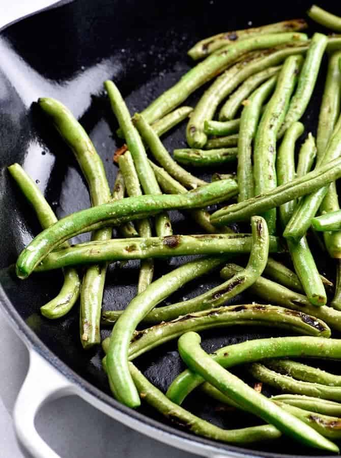 Blistered Green Beans Recipe - These green beans make a quick and easy side dish! Ready in minutes and a delicious favorite! // addapinch.com