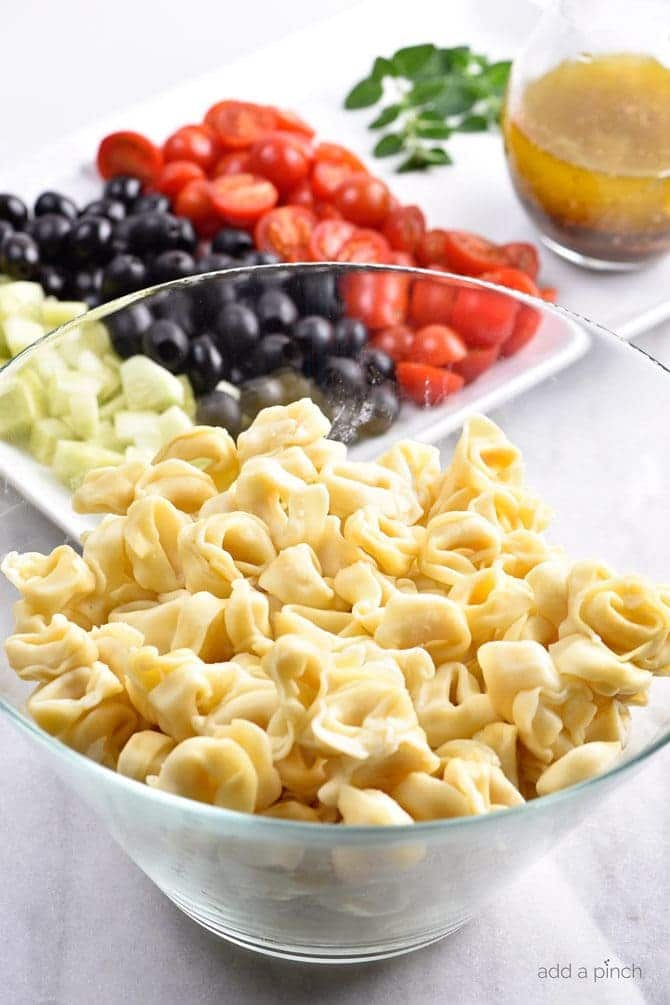 Easy Tortellini Pasta Salad Recipe - This easy Tortellini Pasta Salad recipe is a summer staple! Perfect for picnics, potlucks, reunions, or to make ahead for easy meals, this is a pasta salad you'll turn to time and again! // addapinch.com