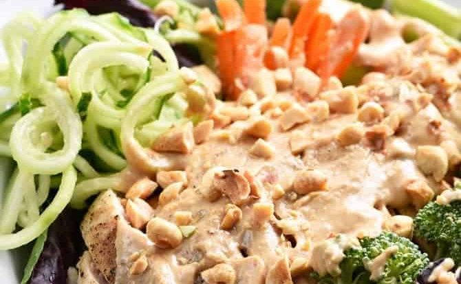 Asian Chicken Salad Recipe - This Asian chicken salad recipe is filled to the brim with flavor! A crisp salad topped with tender chicken, vegetables and a delicious peanut sauce for dressing! // addapinch.com