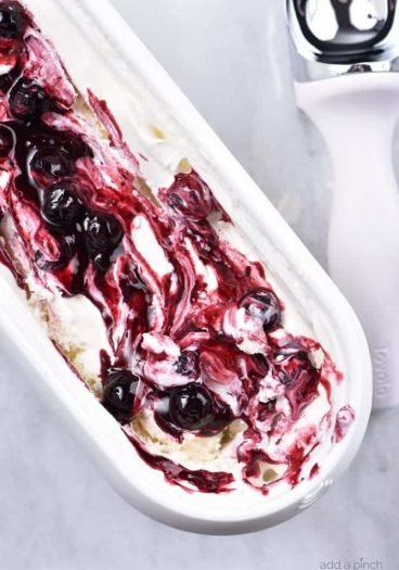 Blueberry Cheesecake Ice Cream Recipe - This Blueberry Cheesecake Ice Cream recipe makes an easy and delicious dessert recipe! A family favorite, this includes a churn and a no-churn ice cream recipe method! // addapinch.com