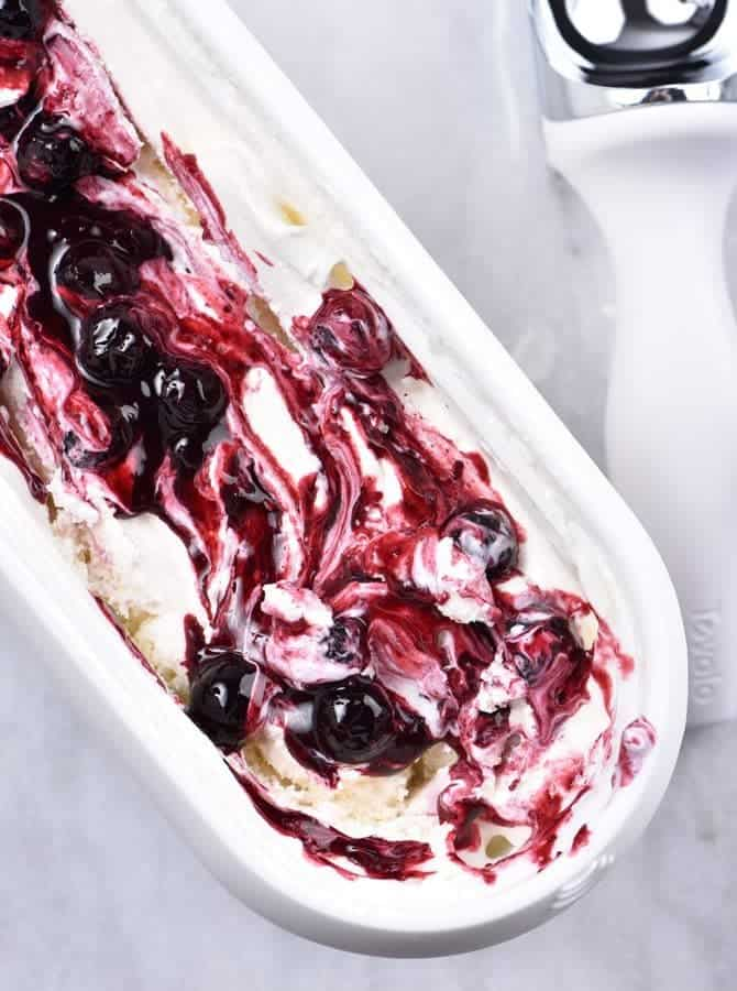 Blueberry Cheesecake Ice Cream Recipe - This Blueberry Cheesecake Ice Cream recipe makes an easy and delicious dessert recipe! A family favorite, this includes a churn and a no-churn ice cream recipe method! // addapinch.com
