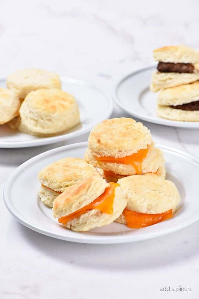 Make Ahead Biscuits Recipe - Make and bake biscuits ahead of time for quick and easy mornings! In less than 30 minutes, you'll have a week's worth of breakfast ready to grab, reheat and go! // addapinch.com