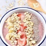 Strawberry Banana Smoothie Bowl Recipe - This strawberry banana smoothie bowl makes a flavorful and delicious fruit, nut, and oat smoothie bowl! Great for breakfast or an afternoon treat! // addapinch.com