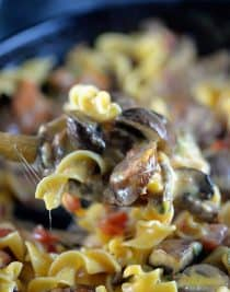 Cheesy Mushroom Sausage Pasta Recipe - This cheesy mushroom sausage pasta skillet makes a delicious, quick meal. Made with portobello mushrooms, sausage, pasta, and lots of cheese, this one skillet pasta recipe is a people pleaser! // addapinch.com