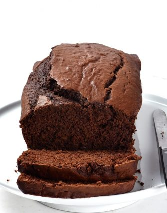 Chocolate Banana Bread Recipe - Take your banana bread to a whole new level with this incredibly most and delicious chocolate banana bread recipe! A definite family favorite! // addapinch.com