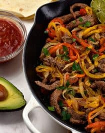 Steak Fajitas Recipe - Steak fajitas make a quick and easy meal perfect for weeknight suppers or weekend celebrations! // addapinch.com