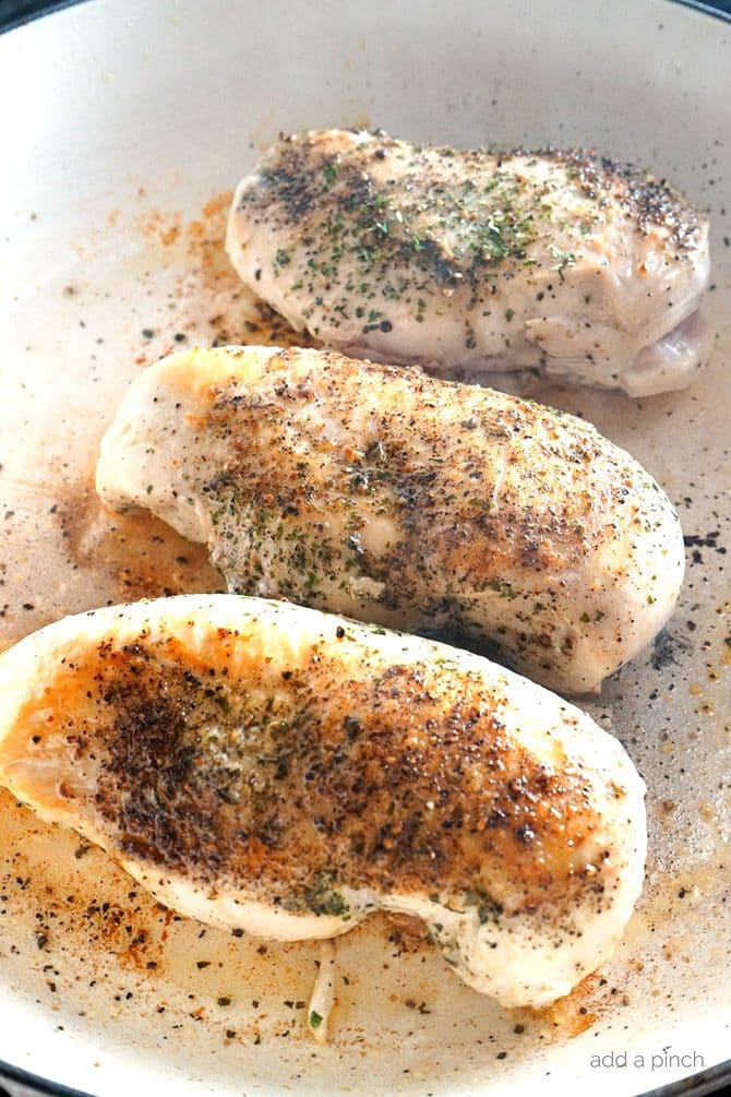 Skillet Garlic Basil Chicken Recipe - This quick and easy, one skillet Garlic Basil Chicken recipe comes together quickly for a fresh, delicious meal the whole family will love! Made with less than 10 ingredients and ready in less than 30 minutes! // addapinch.com