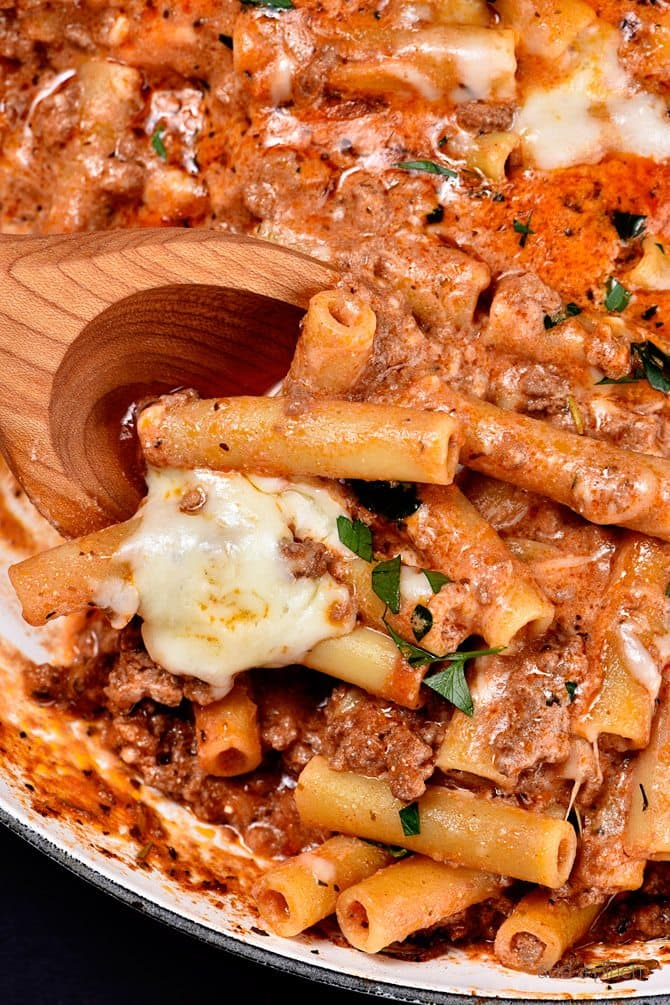 Skillet Beef Ziti and wooden spoon - addapinch.com