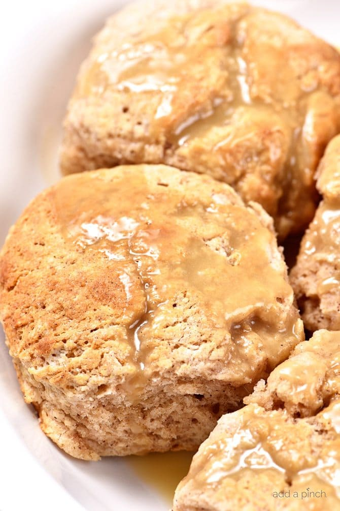 These Sweet Cinnamon Biscuits practically scream fall! But then, when you drizzle them with this Apple Cider Glaze, they become ethereal! So easy to prepare, this is one biscuit recipe that you will want to make again and again! // addapinch.com