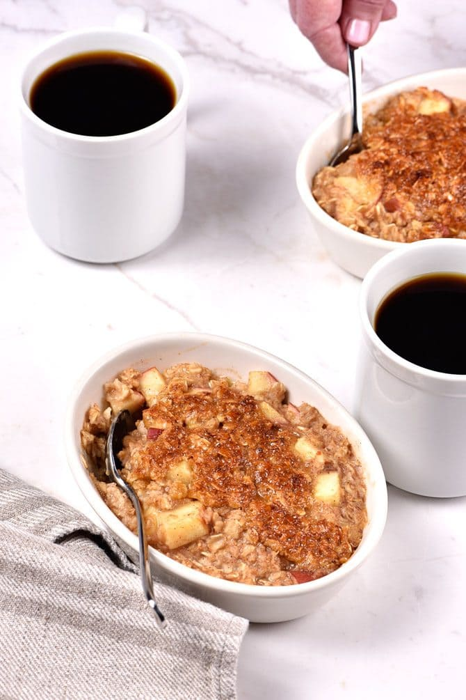 Apple Crisp Oatmeal - Apple Crisp Oatmeal is the perfect combination of everyone's favorite fall dessert and breakfast! Ready in minutes, my apple crisp oatmeal is definitely a family favorite! // addapinch.com