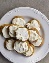 Pumpkin Cookies Recipe with Maple Buttercream Frosting - Pumpkin Cookies with Maple Frosting Recipe make for a soft, delicious cookie recipe! A simple, yet flavorful cookie recipe topped with maple buttercream frosting! // addapinch.com