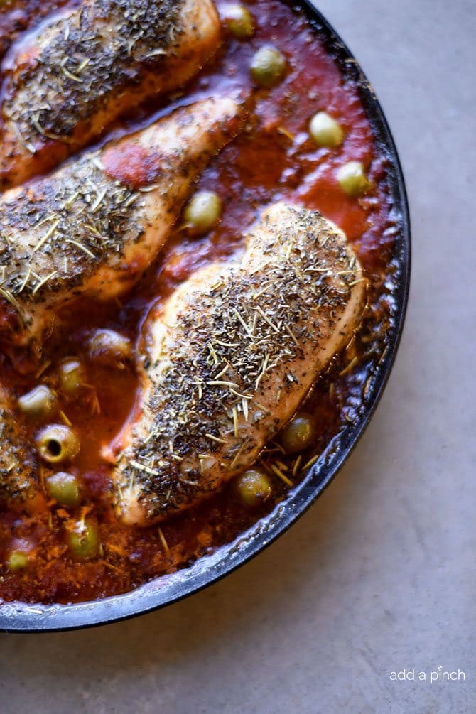 Skillet Mediterranean Chicken Recipe - This quick and easy skillet chicken recipe is packed full of flavor! Simple enough for a busy weeknight, yet perfect for entertaining! // addapinch.com