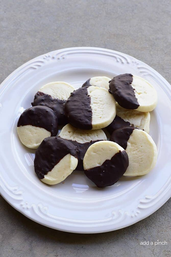Chocolate Dipped Shortbread Cookies Recipe make a festive and delicious cookie recipe that chocolate lovers adore! Perfect for a make ahead cookie recipe! // addapinch.com