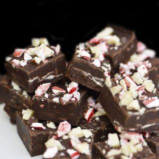 Peppermint Fudge Recipe - Peppermint Fudge makes a holiday favorite fudge recipe! A mint and chocolate lovers' dream! // addapinch.com