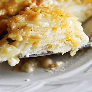 Scalloped Potatoes Recipe - This easy scalloped potatoes recipe is so creamy, cheesy, and out of this world delicious! // addapinch.com