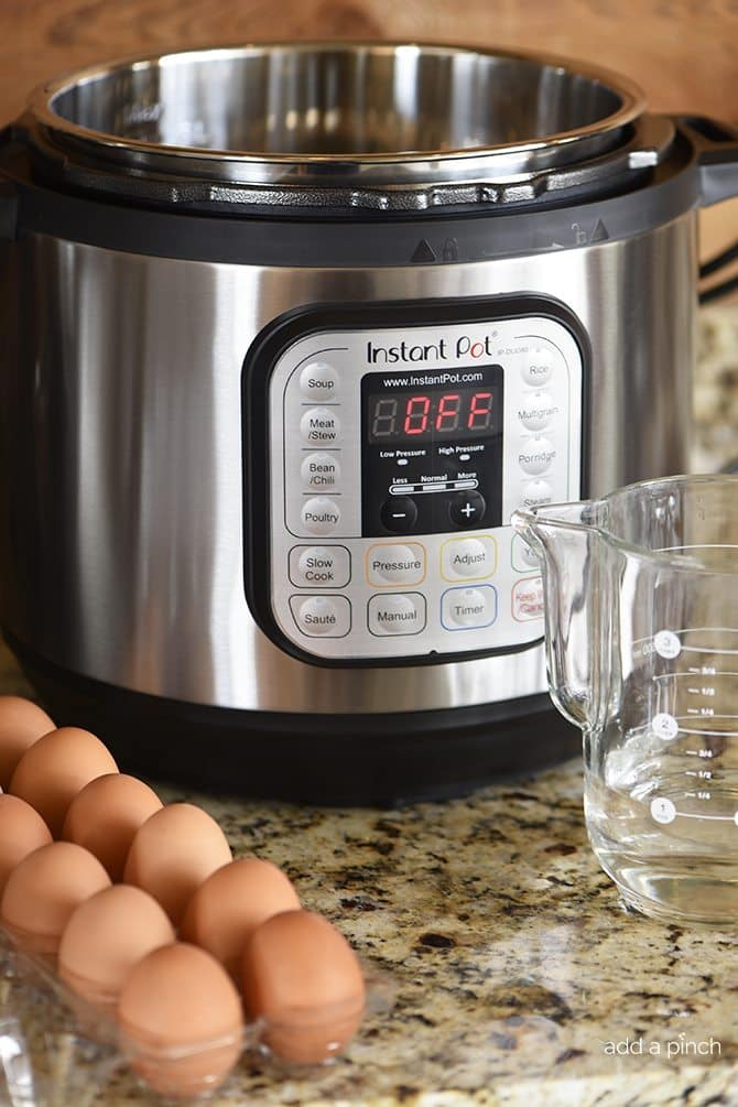 "Instant Pot Hard ""Boiled"" Eggs Recipe - Instant Pot Hard ""Boiled"" Eggs are perfectly cooked and so easy to peel when cooked in the pressure cooker. Quick, easy and fail proof hard boiled eggs every time. // addapinch.com"