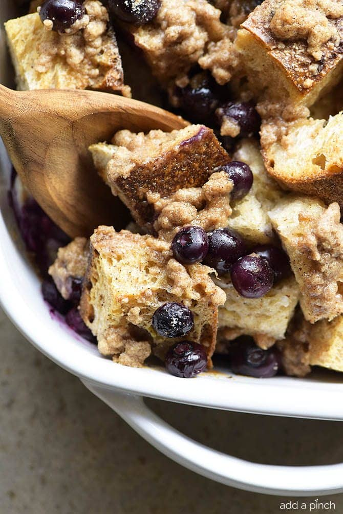 Baked Blueberry French Toast Recipe - This Baked Blueberry French Toast makes a delicious breakfast or brunch recipe! Made with bread, blueberries, maple syrup and topped with a streusel topping, this is always a favorite! // addapinch.com