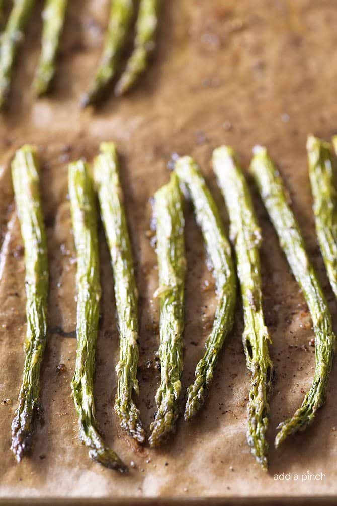 Garlic Butter Roasted Asparagus Recipe - Garlic Butter Roasted Asparagus makes a quick and easy, delicious side dish! // addapinch.com