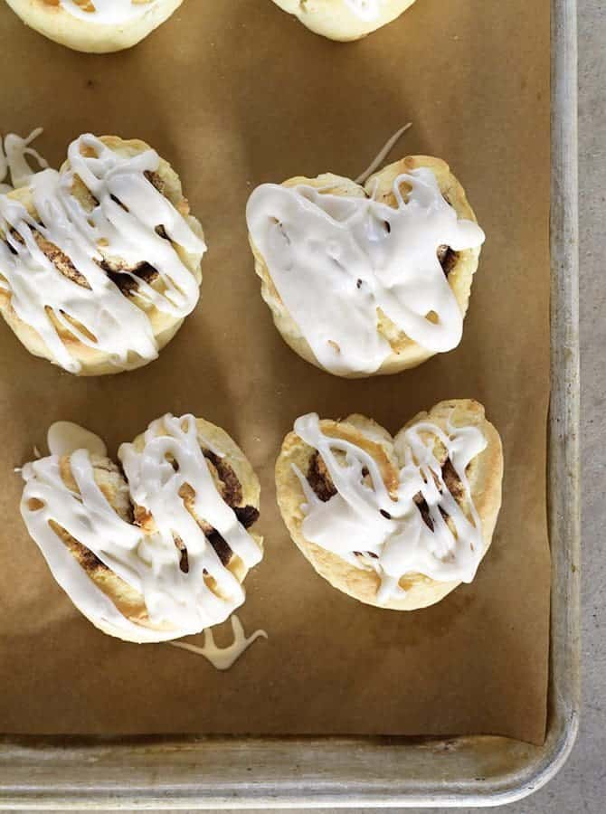 Heart-shaped Cinnamon Rolls Recipe - Heart-Shaped Cinnamon Roll Biscuits make a quick and easy recipe perfect for breakfast, brunch or dessert! All the flavor of a cinnamon roll with the simplicity of a biscuit! // addapinch.com