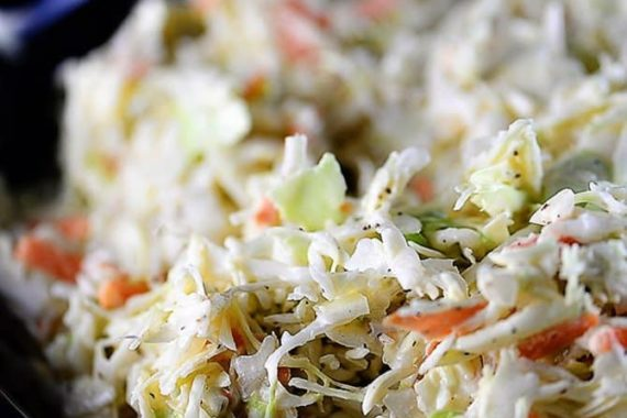 Coleslaw Recipe - A classic coleslaw recipe. Made of cabbage and topped with a delicious dressing, this coleslaw recipe is one you'll use again and again! // addapinch.com