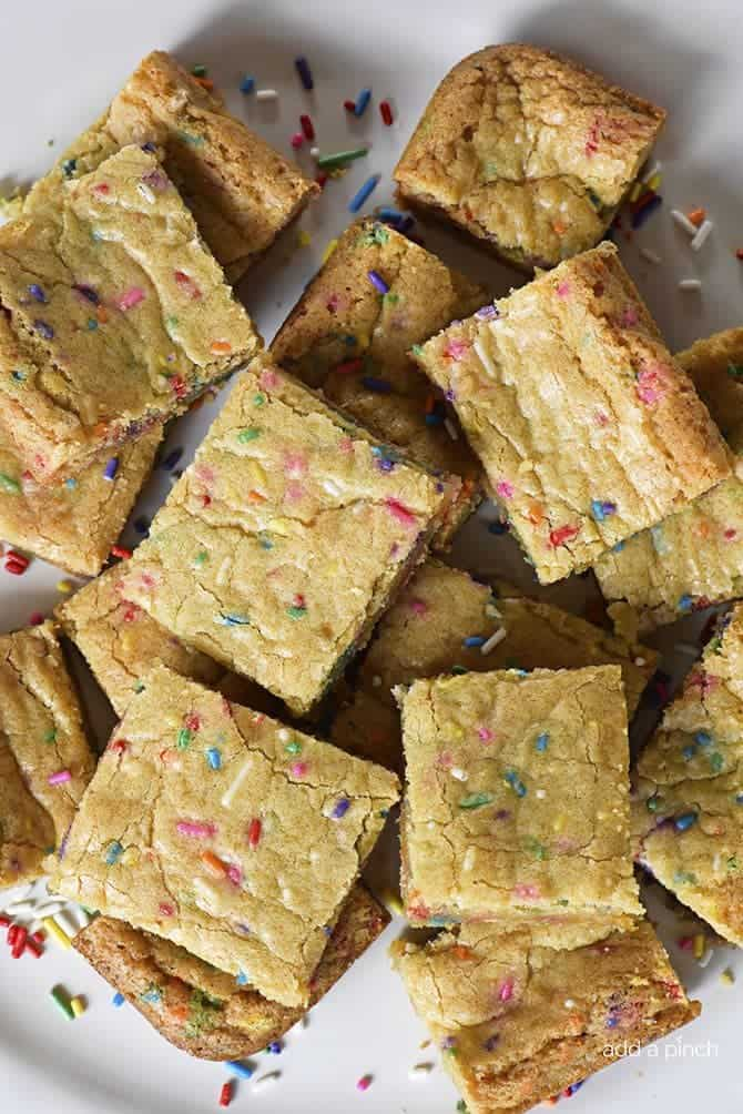 Funfetti Blondies Recipe - Funfetti Blondies make just the perfect bar cookie for celebrations! Made from scratch, these funfetti blondies are chewy, delicious and so fun! // addapinch.com