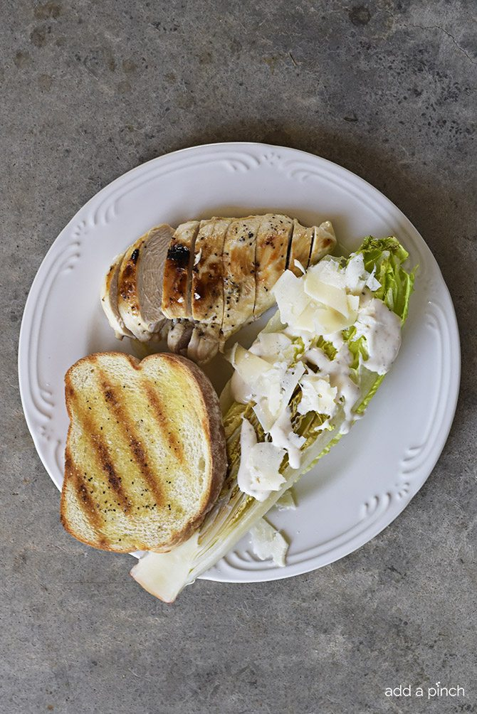 Grilled Caesar Salad Recipe - This Grilled Caesar Salad made a delicious twist on a classic caesar salad recipe. Ready in less than 30 minutes, the added char from the grill adds just the right amount of smokiness to the salad while still leaving it crisp. // addapinch.com