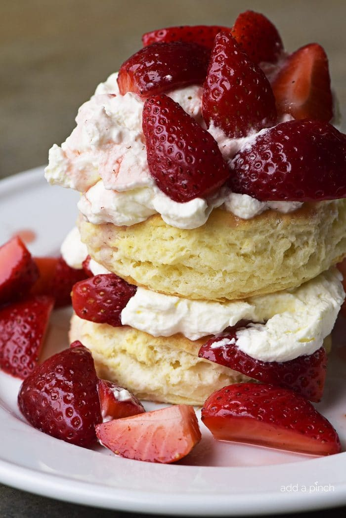 Strawberry Shortcake Recipe - Strawberry Shortcakes with Sweet Cream Cheese Biscuits make a simple, yet scrumptious dessert recipe perfect for spring and summer! // addapinch.com