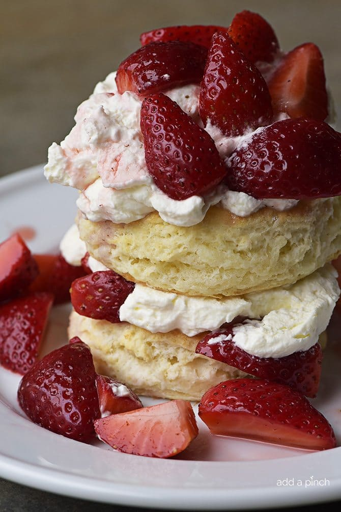 Strawberry Shortcake with Sweet Cream Cheese Biscuits Recipe - Strawberry Shortcakes with Sweet Cream Cheese Biscuits make a simple, yet scrumptious dessert recipes perfect for spring and summer! // addapinch.com
