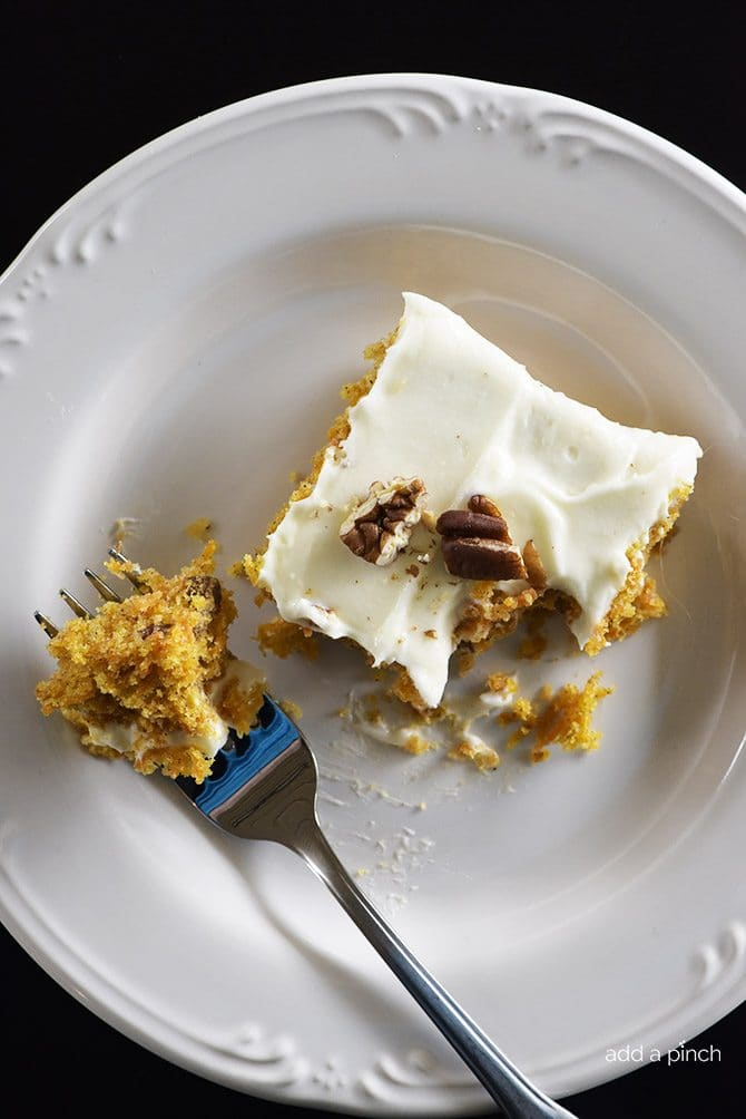 Easy Carrot Cake Sheet Cake Recipe - This Easy Carrot Cake Sheet Cake recipe comes together easily and bakes into a beautiful, delicious carrot cake! Topped with a fluffy cream cheese frosting, this carrot cake is one everyone asks for the recipe! // addapinch.com