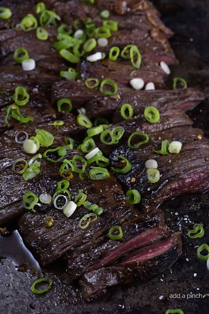 Honey Soy Skirt Steak Recipe - This honey, soy, garlic, and ginger marinade is delicious with ribeye, flank or skirt steak! Skirt steak cooks quickly, making it perfect for a weeknight, or weekend favorite! // addapinch.com