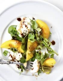 Peach, Basil and Burrata Salad Recipe - A delicious take on a traditional caprese salad, this peach, basil and burrata salad comes together in minutes and is just as delicious as it is beautiful. // addapinch.com