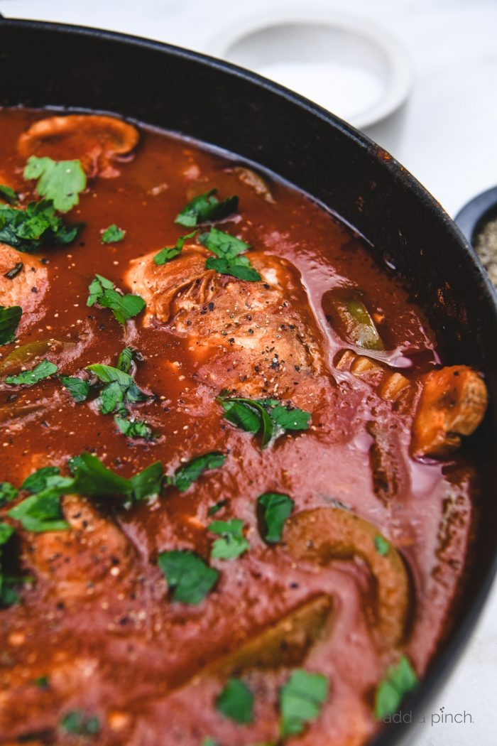 The Best Chicken Cacciatore made in a rich tomato and the most tender chicken is classic Italian comfort food at its best! // addapinch.com