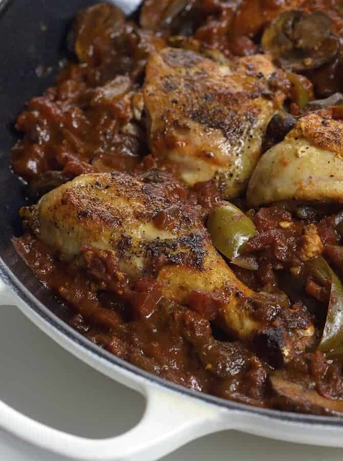 Chicken Cacciatore Recipe - Chicken Cacciatore made in a flavorful tomato sauce and tender chicken is a simple, yet comforting Italian classic at its best. // addapinch.com