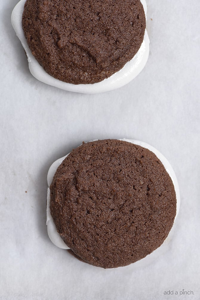 These Chocolate Marshmallow Sandwich Cookies make a delicious cookie recipe that chocolate lovers adore! So easy to make and fun to eat! // addapinch.com