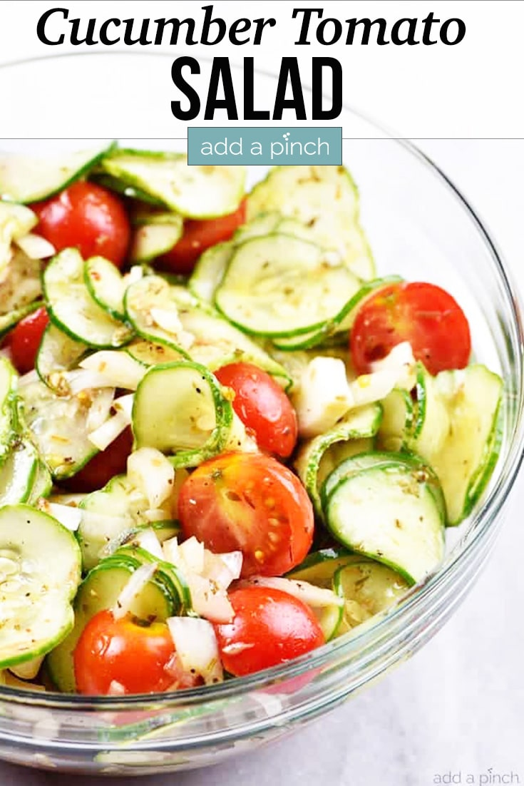 Cucumber Tomato Salad in glass bowl - with text - addapinch.com