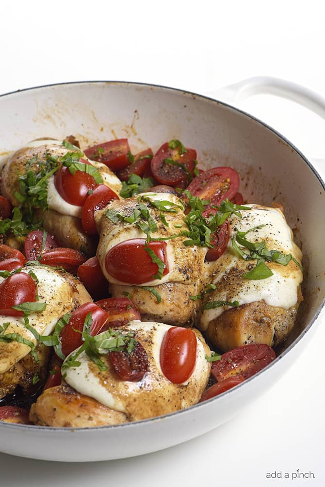 Skillet Caprese Chicken Recipe - This quick and easy chicken recipe is perfect for busy weeknights and delicious enough for entertaining! // addapinch.com
