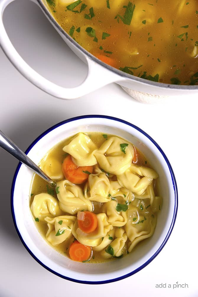 Tortellini Soup is perfect for busy nights! Made with vegetables, cheesy tortellini and topped with fresh parmesan! Ready and on the table in 30 minutes! // addapinch.com