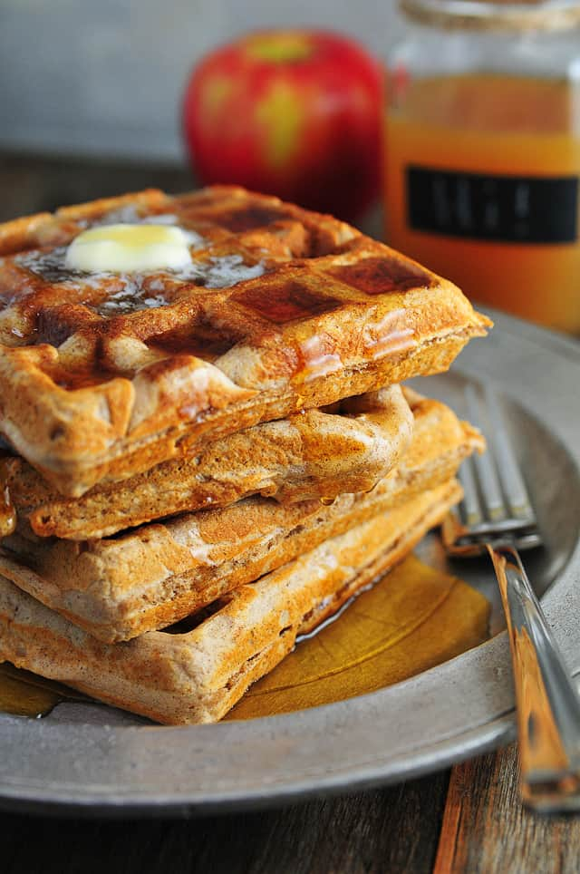 photograph of waffles on a metal plate.