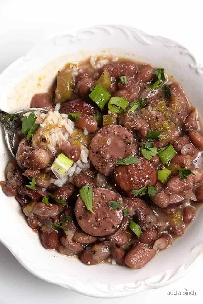 Slow Cooker Red Beans and Rice Recipe - A  traditional Creole red beans and rice recipe that everyone loves made easy in the slow cooker!  // addapinch.com