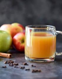 Homemade Apple Cider Recipe - Easy and delicious homemade apple cider recipe made with apples, oranges, cinnamon, and cloves. Stovetop and slow cooker instructions included! // addapinch.com