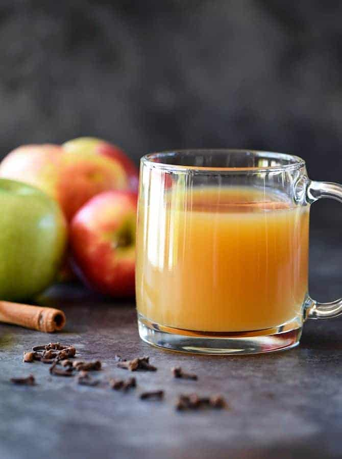 Homemade Apple Cider Recipe -Easy and delicioushomemade apple ciderrecipe made with apples, oranges, cinnamon, and cloves. Stovetop and slow cooker instructions included! // addapinch.com