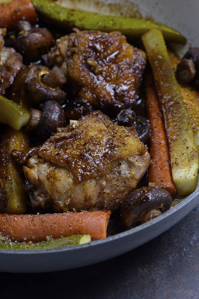 Balsamic Chicken and Vegetables Recipe - This quick and easy one pan balsamic chicken recipe is perfect for weeknight supper or easy entertaining! Ready and on the table in less than 30 minutes! // addapinch.com
