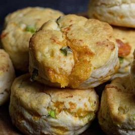 Cheddar Scallion Biscuits Recipe - Tender and delicious, these fluffy, cheesy cheddar scallion biscuits make the perfect addition to any meal and couldn't be easier! // addapinch.com