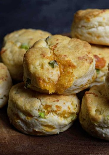 Cheddar Scallion Biscuits Recipe - Tender and delicious, these fluffy, cheesy cheddar scallion biscuits make the perfect addition to any meal and couldn't be easier!// addapinch.com