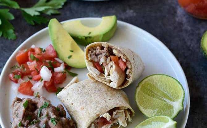 Shredded Chicken Burritos Recipe - This traditional chicken burrito makes a quick and easy meal comes together in a snap for a favorite lunch or supper!// addapinch.com