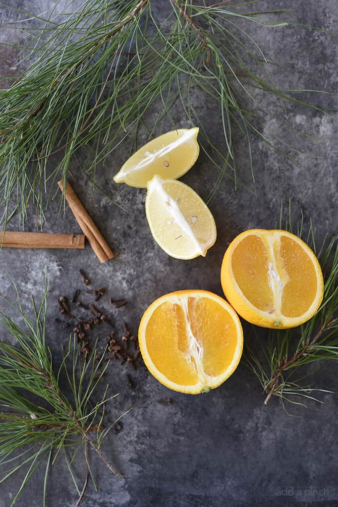 Pine Citrus Potpourri - This all natural, quick and easy potpourri recipe makes your home smell amazing with fresh fruits, spices, and a touch of pine! // addapinch.com