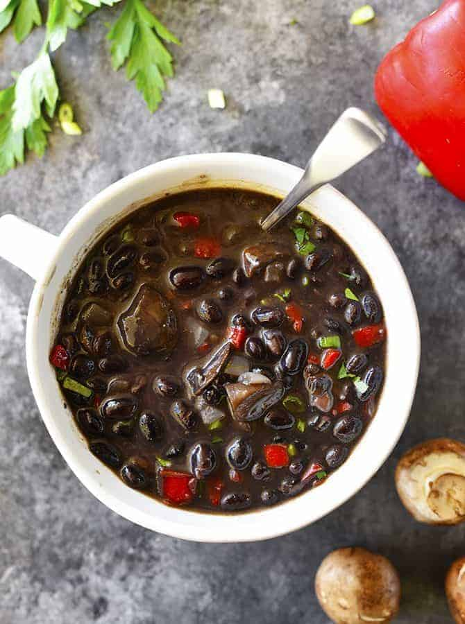 Red Pepper Mushroom Black Bean Soup Recipe - This quick and easy black bean soup recipe comes together in a snap for a vegetarian soup recipe that even meat lovers with adore! // addapinch.com